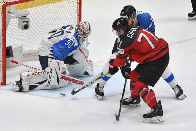 761b2ccd1bfd7 Na snímke Anthony Cirelli (Kanada) a brankár Kevin Lankinen (Fínsko) vo  finálovom zápase Kanada - Fínsko na 83. majstrovstvách sveta v ľadovom  hokeji v ...